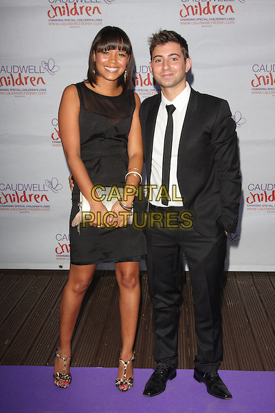 Leah Gooding and Ricky Boleto.Caudwell Childrens' Butterfly Ball at the Battersea Evolution, London, England. September 15th 2011.full length dress suit shirt tie silver clutch bag black white  .CAP/JIL.©Jill Mayhew/Capital Pictures