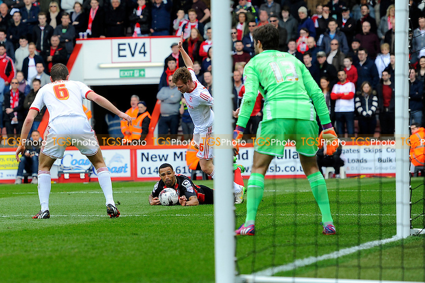Callum Wilson of AFC Bournemouth goes down in the penalty area after a tackle by Tomas Kalas of Middlesbrough - AFC Bournemouth vs Middlesbrough - Sky Bet Championship Football at the Goldsands Stadium, Bournemouth, Dorset - 21/03/15 - MANDATORY CREDIT: Denis Murphy/TGSPHOTO - Self billing applies where appropriate - contact@tgsphoto.co.uk - NO UNPAID USE