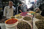 A Palestinians shop at a popular market during preparing for Islam's holy month of Ramadan in Gaza City on August 19, 2009. Ramadan is a Muslim religious observance that takes place during the ninth month of the Islamic calendar, believed to be the month in which the Quran began to be revealed. It is the Islamic month of fasting, in which Muslims don't eat or drink anything from sunrise 'till sunset. Fasting is meant to teach the person patience and humility. Photo By Abed Rahim Khatib