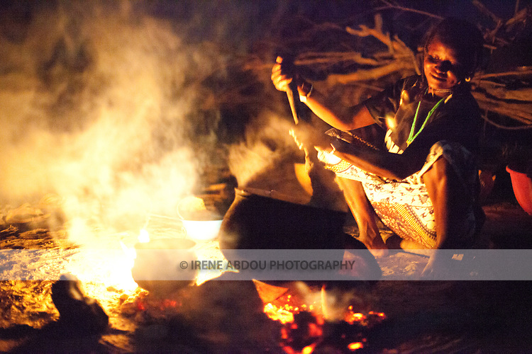 In the remote Fulani village of Pete Goonga in northern Burkina Faso, a woman prepares dinner on an open fire.