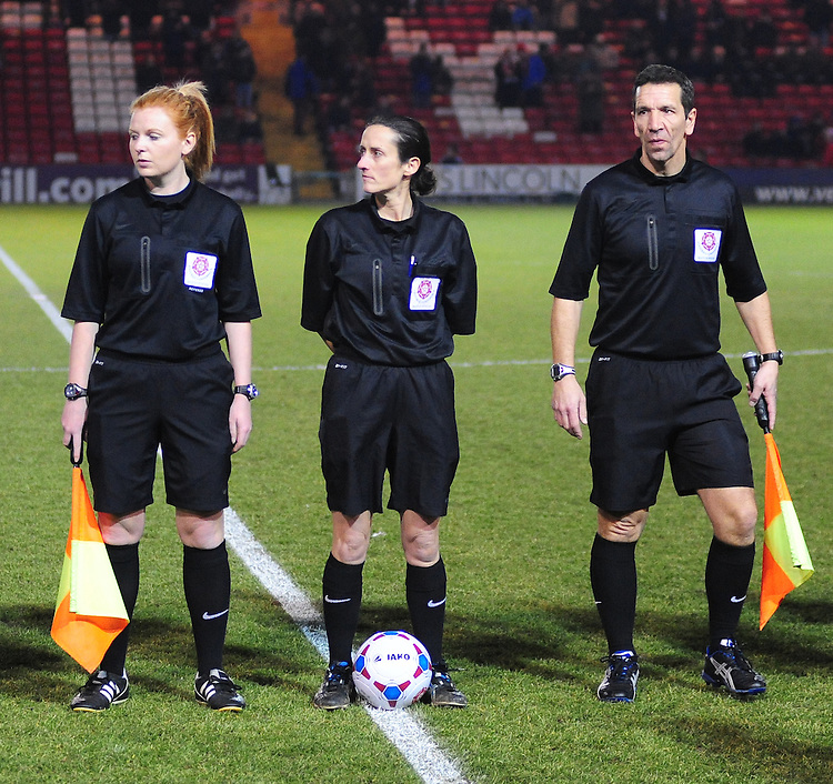 Assistant referee Helen Byrne, left, Referee Amy Fearn, centre, and Assistant referee Stuart Richardson <br /> <br /> (Photo by Chris Vaughan/CameraSport)<br /> <br /> Football - The Skrill Premier - Lincoln City v Gateshead - Tuesday 10th December 2013 - Gelder Group Sincil Bank Stadium - Lincoln<br /> <br /> &copy; CameraSport - 43 Linden Ave. Countesthorpe. Leicester. England. LE8 5PG - Tel: +44 (0) 116 277 4147 - admin@camerasport.com - www.camerasport.com