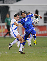 El Salvador forward Cristian Castillo (12) fights for possession of the ball against Guatemalan midfielder Carlos Figueroa (12)  The Guatemalan National Team defeated  El Salvador National Team 2-0 in a friendly international at RFK Stadium, Saturday September 7, 2010.
