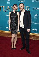 "HOLLYWOOD, CA - FEBRUARY 13: Yan Tual, Romane Portail, at the Premiere Of Starz's ""Outlander"" Season 5 at HHollywood Palladium in Hollywood California on February 13, 2020. Credit: Faye Sadou/MediaPunch"