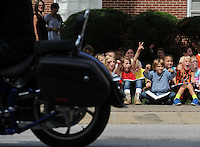 NWA Democrat-Gazette/ANDY SHUPE<br /> Ella Lausin, 9 (from left); Makenzie Warren, 10; Owen Chandler, 9; and Jacob Nordin, 9; all fourth-graders at Washington Elementary School, cheer Thursday, Sept. 24, 2015, while counting motorcycles as they pass by on Dickson Street in Fayetteville. The students were collecting data that they will use in their mathematics classes in the coming days.