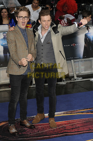 Tom Fletcher &amp; Danny Jones of McFly<br /> 'Man Of Steel' UK film premiere, Empire cinema, Leicester Square, London, England.<br /> 12th June 2013<br /> full length brown grey gray suit jacket waistcoat hand arm on over shoulder black jeans denim fists in air mouth open<br /> CAP/CAN<br /> &copy;Can Nguyen/Capital Pictures