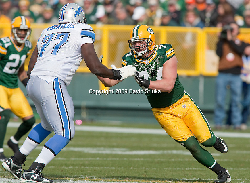 Green Bay Packers linebacker Aaron Kampman (74) battles against Detroit Lions offensive lineman Gosder Cherilus (77) during an NFL football game at Lambeau Field in Green Bay, WIsconsin on Oct. 18, 2009. The Packers won the game 26-0. (AP Photo/David Stluka)