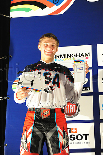 05.27.2012. England, Birmingham, National Indoor Arena. UCI BMX World Championships. Cole Tesar (USA) on the podium receiving 1st prize for the Cruisers Boys 15 and 16 Finals at the NIA ....