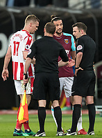 Andy Carroll of West Ham United talks with Referee Michael Oliver at full time during the Premier League match between West Ham United and Stoke City at the Olympic Park, London, England on 16 April 2018. Photo by Andy Rowland.