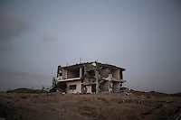 "n this Sunday, Aug. 17, 2014 photo, a building house stands at the edge of Shuyaja neighborhood after it was targeted by artillery shelling during the ""Protective Edge"" Israeli military operation in Gaza Strip. (Photo/Narciso Contreras)"