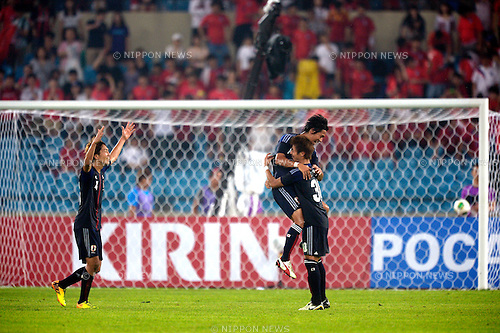 (L-R) Genki Haraguchi, Hiroki Yamada, Yoichiro Kakitani (JPN),<br /> JULY 28, 2013 - Football / Soccer :<br /> Yoichiro Kakitani of Japan celebrates with his teammates Hiroki Yamada and Genki Haraguchi after scoring the winning goal during the EAFF East Asian Cup 2013 match between South Korea 1-2 Japan at Jamsil Olympic Stadium in Seoul, South Korea. (Photo by FAR EAST PRESS/AFLO)