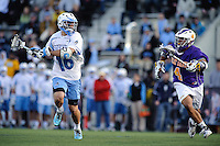 Baltimore, MD - April 5: Midfielder Daley Baker # 4 of the Albany Great Dane's attempts to stop Midfielder Lee Coppersmith #16 of the John Hopkins Blue Jays during the Albany v Johns Hopkins mens lacrosse game at  Homewood Field on April 5, 2012 in Baltimore, MD. (Ryan Lasek/Eclipse Sportwire)