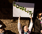 February 11, 2017. Raleigh, North Carolina.<br /> <br /> Anne Brandon Braswell of Garner, held an equality sign during the speeches at the end of the HKONJ march. <br /> <br /> Thousands gathered in downtown Raleigh for the annual HKONJ People's Assembly, a civil rights march tied to the Moral Monday movement. Supporters from around the state gathered to march and speak out against nationwide attacks on civil rights and the Trump administration.<br /> <br /> Jeremy M. Lange for The New York Times