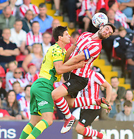 Lincoln City's Luke Waterfall vies for possession with Norwich City's Time Klosse<br /> <br /> Photographer Andrew Vaughan/CameraSport<br /> <br /> Football Pre-Season Friendly - Lincoln City v Norwich City - Tuesday 10th July 2018 - Sincil Bank - Lincoln<br /> <br /> World Copyright &copy; 2018 CameraSport. All rights reserved. 43 Linden Ave. Countesthorpe. Leicester. England. LE8 5PG - Tel: +44 (0) 116 277 4147 - admin@camerasport.com - www.camerasport.com