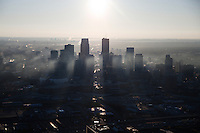 Rays of haze shoot through the skyscrapers of Minneapolis, Minnesota in this aerial view.