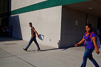 Lindsay, California, September 5, 2012 - Students walk to class at Lindsay High School. ..The school began building a competency-based education model about 7 years ago, fully implementing it just over three years ago and is set to graduate its first class this school year. This model does away with traditional grading and pass/fail for grades. Instead students are expected to achieve proficiency in a range of areas in each class, where a 3 (equal to a traditional B) is passing; A 4 is considered intensive and usually denotes college bound. Says Principal Jaime Robles, ?This allows students to learn at there own pace. If a student is advanced, they can move ahead, and if a student is lagging, they get the support they need.? Part of this model allows for students who are more advanced dig deeper and push harder and truly move ahead of others. Because they are ahead, some spend the extra time learning more, others take concurrent classes at the nearby community college and some choose to graduate early to start their path. ?Each student has their own set of goals,? says English teacher Amalia Lopez, ?Whatever their goals are, we support them.?.Slug: DD_ CompetencyByline: Daryl Peveto / LUCEO for Education Week
