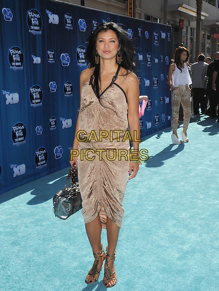 "Kelly Hu.""Phineas and Ferb"" Los Angeles Premiere held at the El Capitan Theatre, Hollywood, California, USA..August 3rd, 2011.full length dress black gold silver ruched dress                         .CAP/RKE/DVS.©DVS/RockinExposures/Capital Pictures."