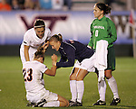 07 November 2008: Virginia teammates console Nikki Krzysik (23) after Krzysik's penalty kick was saved to allow Virginia Tech to advance to the final. The University of Virginia and Virginia Tech played to a 1-1 tie after 2 overtimes at WakeMed Stadium at WakeMed Soccer Park in Cary, NC in a women's ACC tournament semifinal game.  Virginia Tech advanced to the final on penalty kicks, 2-1.