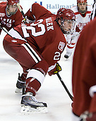 David Valek (Harvard - 22) - The Harvard University Crimson defeated the Boston University Terriers 5-4 in the 2011 Beanpot consolation game on Monday, February 14, 2011, at TD Garden in Boston, Massachusetts.