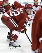 David Valek (Harvard - 22) - The Harvard University Crimson defeated the Boston University Terriers 5-4 in the 2011 Beanpot consolation game on Monday, February 14, 2011, at TD Garden in Boston, Massachusetts.