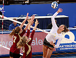 BROOKINGS, SD - OCTOBER 3:  Nola Basey #7 and Sarah Schmid #3 from Denver look to block a kill attempt by Wagner Larson #11 from South Dakota State University in the first game of their match Friday night at Frost Arena. (Photo/Dave Eggen/Inertia)