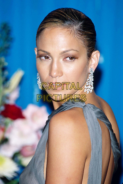 JENNIFER LOPEZ.Ref: 10754.j lo, dangly diamond earrings, sleeveless, looking over shoulder, headshot, portrait.www.capitalpictures.com.sales@capitalpictures.com.©Capital Pictures