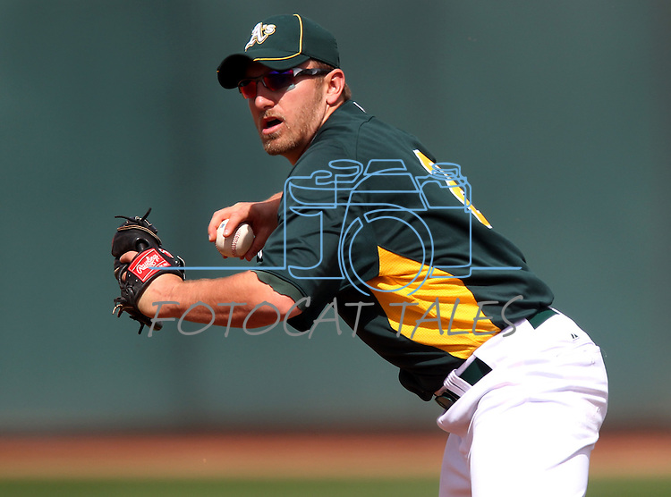 Oakland A's infielder Cliff Pennington makes a throw during a Cactus League preseason game between the Dodgers and the A's in Scottsdale, Ariz., on Wednesday, March 7, 2012. The game ended 3-3..Photo by Cathleen Allison