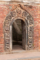 Nepal, Patan.  Durbar Square.  Gate to Royal Palace Compound, Hindu Carvings for Decoration.