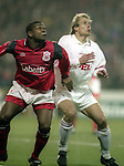 Des Little of Nottingham Forest  and Jurgen Klinsmann of Bayern Munich -vUEFA Cup - quarter final 2nd leg - Nottingham Forest v Bayern Munich - City Ground - Nottingham - England - 19th March 1996 - Picture Simon Bellis/Sportimage