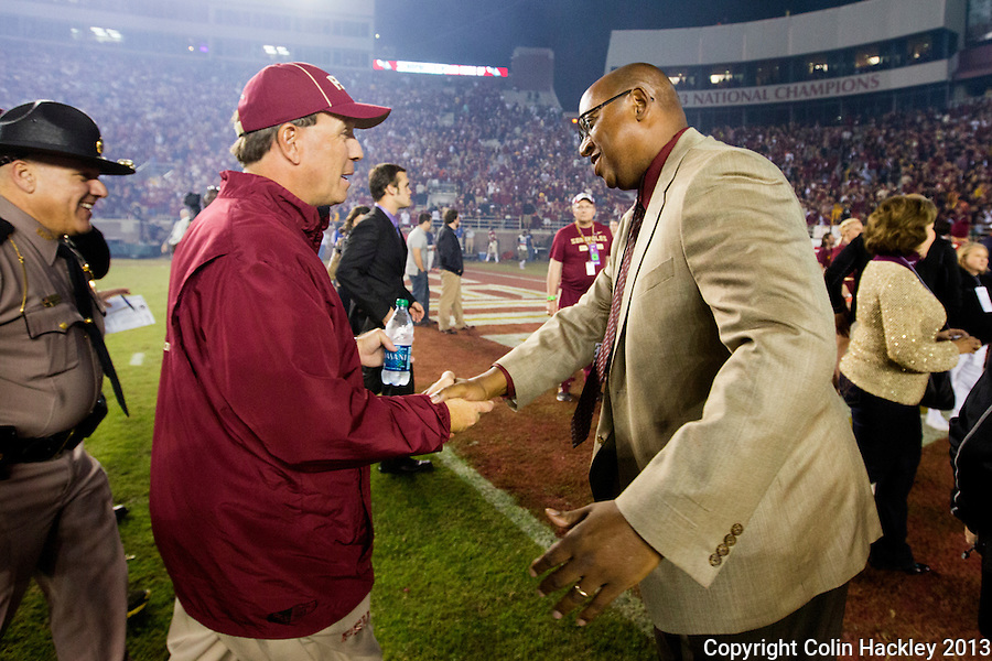 TALLAHASSEE, FL 11/2/13-FSU-MIAMI110213CH-Florida State Head Coach Jimbo Fisher, left is greeted by Athletic Director Stan Wilcox after the Miami game Saturday at Doak Campbell Stadium in Tallahassee. The Seminoles beat the Hurricanes 41-14.<br /> COLIN HACKLEY PHOTO