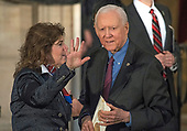 United States Senator Orrin Hatch (Republican of Utah) speaks to an unidentified person as they await the arrival of US President Donald J. Trump for a Congressional Gold Medal ceremony honoring former US Senator Bob Dole (Republican of Kansas) in the Rotunda of the US Capitol on Wednesday, January 17, 2017.  Congress commissioned gold medals as its highest expression of national appreciation for distinguished achievements and contributions.  Dole served in Congress from 1961 through 1996, was the Senate GOP leader from 1985 through 1996, and was the 1996 Republican Party nominee for President of the United States.<br /> Credit: Ron Sachs / CNP