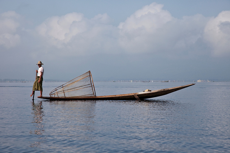 Fisherman with conical fish trap on Inle Lake