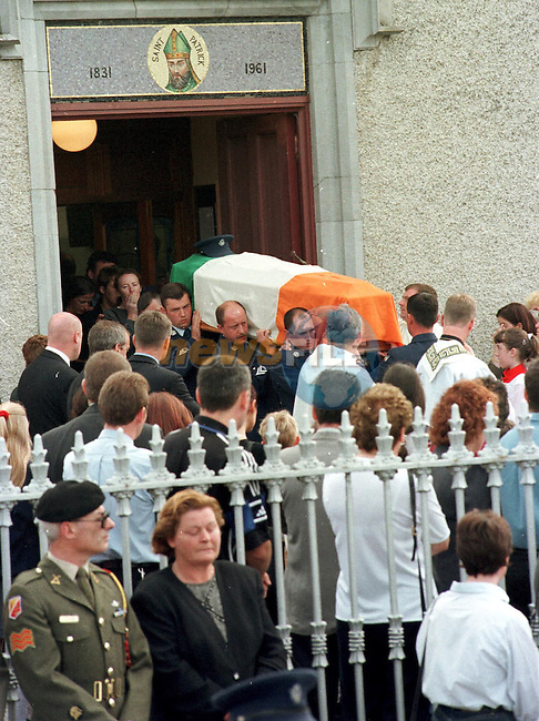 Stg Patrick Mooney remains are carried out of the church in Stamulen Co Meath by fellow Air Corp friends .Pic Fran Caffrey / Newsfile