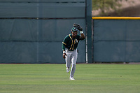 Oakland Athletics center fielder Dairon Blanco (30) catches a fly ball during a Minor League Spring Training game against the Chicago Cubs at Sloan Park on March 13, 2018 in Mesa, Arizona. (Zachary Lucy/Four Seam Images)