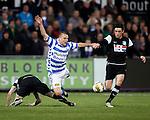 Nederland, Zwolle, 13 april 2012.Jupiler League.Seizoen 2011-2012.Joey van den Berg van FC Zwolle wordt ten val gebracht