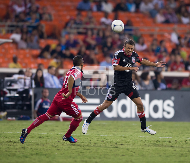 Nick DeLeon (18) of D.C. United heads the ball over Alex (71) of the Chicago Fire at RFK Stadium in Washington, DC.  D.C. United defeated the Chicago Fire, 4-2.