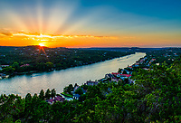 This is a shot we took from Mt. Bonnel in Austin with this wonderful sunset with there ray spanning out in the sky. This scenic landscape vista over Lake Austin and the city of Austin has some stunning city and landscape views.  It is a great spot for locals and tourist to watch the sunset looking west towards the Pennybacker Bridge or looking east to the downtown skyline. The walk up the stair can be a little difficult for some but it is worth the view. You can take a picnic and enjoy the view of the city or the sunset. Just another great Texas Landscape.