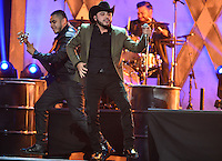CORAL GABLES, FL - APRIL 30: Gerardo Ortiz performs at the 2015 Billboard Latin Music Awards presented bu State Farm on Telemundo at BankUnited Center on April 30, 2015 in Miami, Florida. Credit: MPI10 / MediaPunch