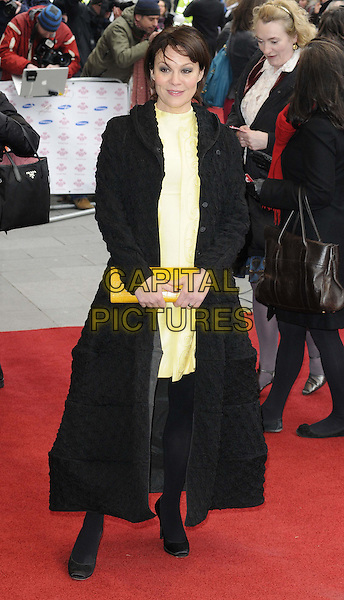 Helen McCrory.The Prince's Trust and Samsung Celebrate Success Awards at the Odeon Leicester Square, London, England..26th March 2013.full length black coat jacket yellow dress clutch bag tights.CAP/CAN.©Can Nguyen/Capital Pictures.