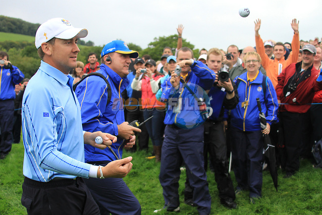2010 Ryder Cup at the Celtic Manor twenty ten course, Newport Wales, 28/9/2010.Ian Poulter throwing some signed balls into the crowd as he leaves the 11th green..Picture Fran Caffrey/www.golffile.ie.