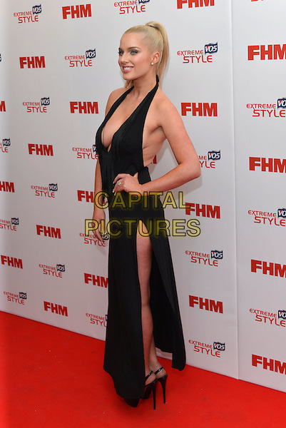 Helen Flanagan.FHM 100 Sexiest Women in the World party, The Sanderson Hotel, London, England 1st May 2013.full length black dress plunging neckline cleavage hand on hip  arm slit split side profile .CAP/PL.©Phil Loftus/Capital Pictures