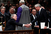 Presidential biographer Jon Meacham, shakes hands with former President George Bush after speaking during the State Funeral for former President George H.W. Bush at the National Cathedral, Wednesday, Dec. 5, 2018, in Washington.<br /> Credit: Alex Brandon / Pool via CNP