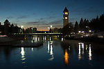 Clock tower and bridge reflecting onto the Spokane River in Riverside park in Spokane at sunset