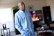 DNA Exonerated prisoner Thomas McGowan, stands in the living room of his home in Garland, Texas.