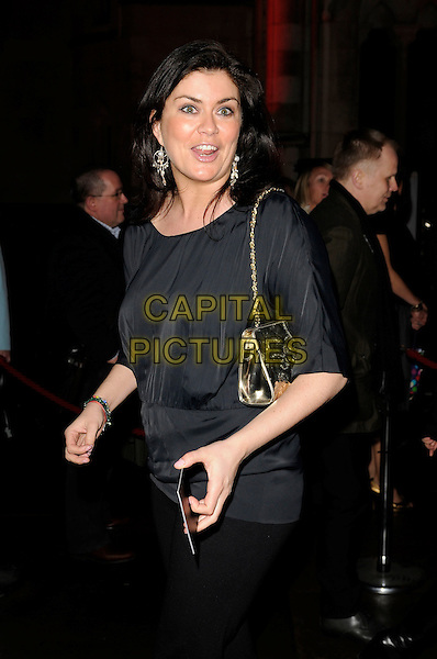 "AMANDA LAMB.""Sweeney Todd: The Demon Barber of Fleet Street"" European film premiere, Odeon cinema, Leicester Square, London, England..January 10th, 2008 .half length black top gold bag purse funny face .CAP/CAN.©Can Nguyen/Capital Pictures"