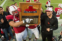 Stanford, CA -- November 23, 2013:  Stanford's David Yankey and Ben Gardner with the Axe after winning its game against Cal at Stanford Stadium. Stanford defeated Cal 63-13.