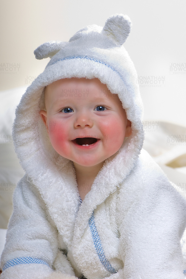 Colour portrait of a baby boy in his bathrobe