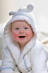 Colour portrait of a baby boy in his bathrobe