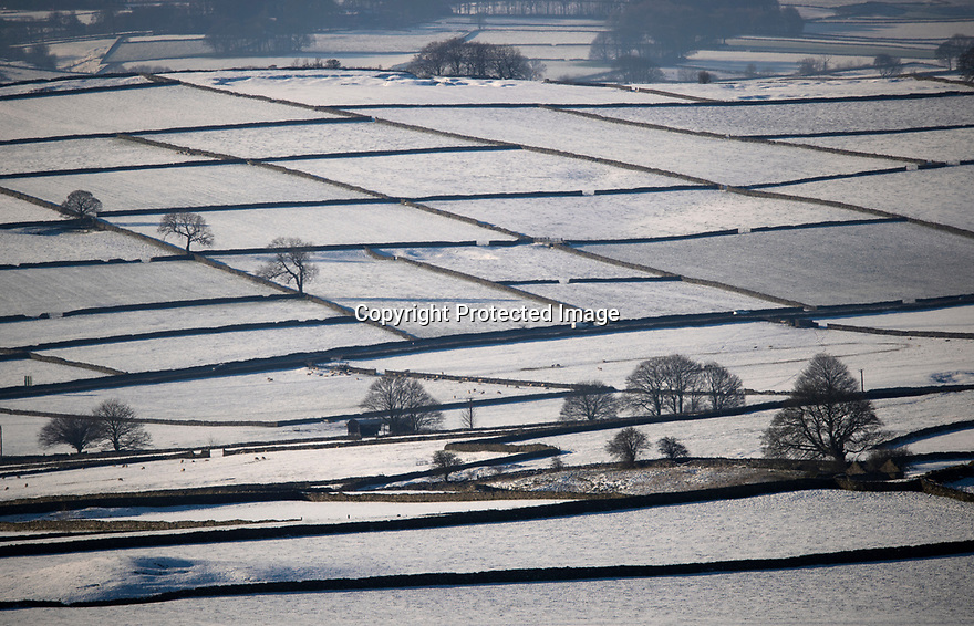 23/01/19<br /> <br /> As seen from Eyam Edge, miles and miles of dry stone walls stretch out over snow covered farmland around Follow in the Derbyshire Peak District.<br /> <br /> All Rights Reserved, F Stop Press Ltd +44 (0)7765 242650  www.fstoppress.com rod@fstoppress.com
