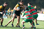 Simon Marcel tries to fend off Joseph Gregory.  Counties Manukau Premier Club rugby game between Pukekohe and Waiuku, played at Colin Lawrie Fields, Pukekohe on Saturday April 14th, 2018. Pukekohe won the game 35 - 19 after leading 9 - 7 at halftime.<br /> Pukekohe Mitre 10 Mega -Joshua Baverstock, Sione Fifita 3 tries, Cody White 3 conversions, Cody White 3 penalties.<br /> Waiuku Brian James Contracting - Lemeki Tulele, Nathan Millar, Tevta Halafihi tries,  Christian Walker 2 conversions.<br /> Photo by Richard Spranger