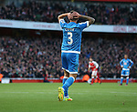 Bournemouth's Steve Cook looks on dejected after his mistake gifts Arsenal their opening goal during the Premier League match at the Emirates Stadium, London. Picture date October 26th, 2016 Pic David Klein/Sportimage